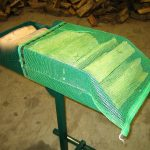Firewood bag loading tray